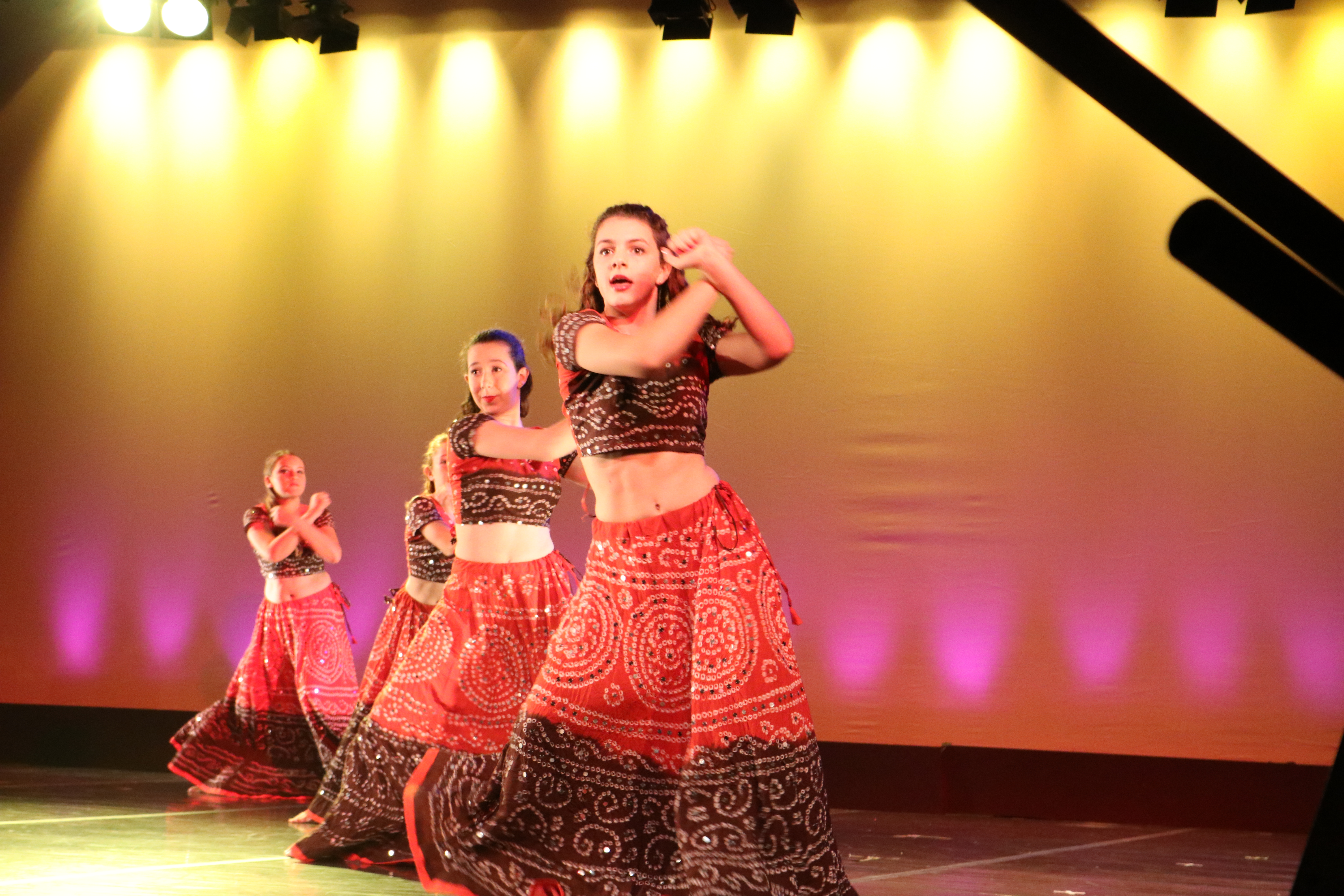 Cate Herman '21, Mira Chaskes '20 and Nina Fisher '22 dance a Bollywood-inspired routine.