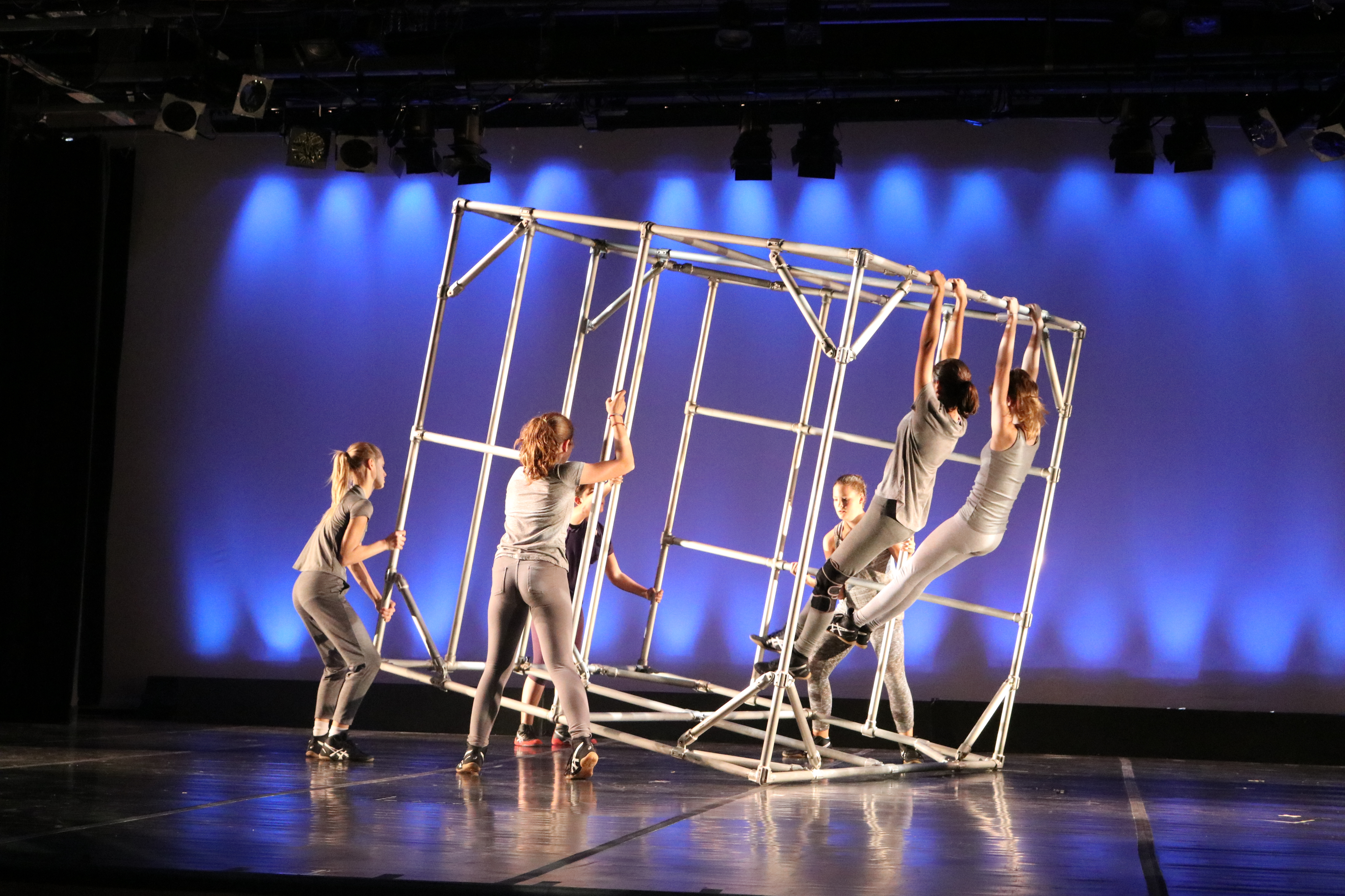 Students use a metal box inspired by the dance company Diavolo.