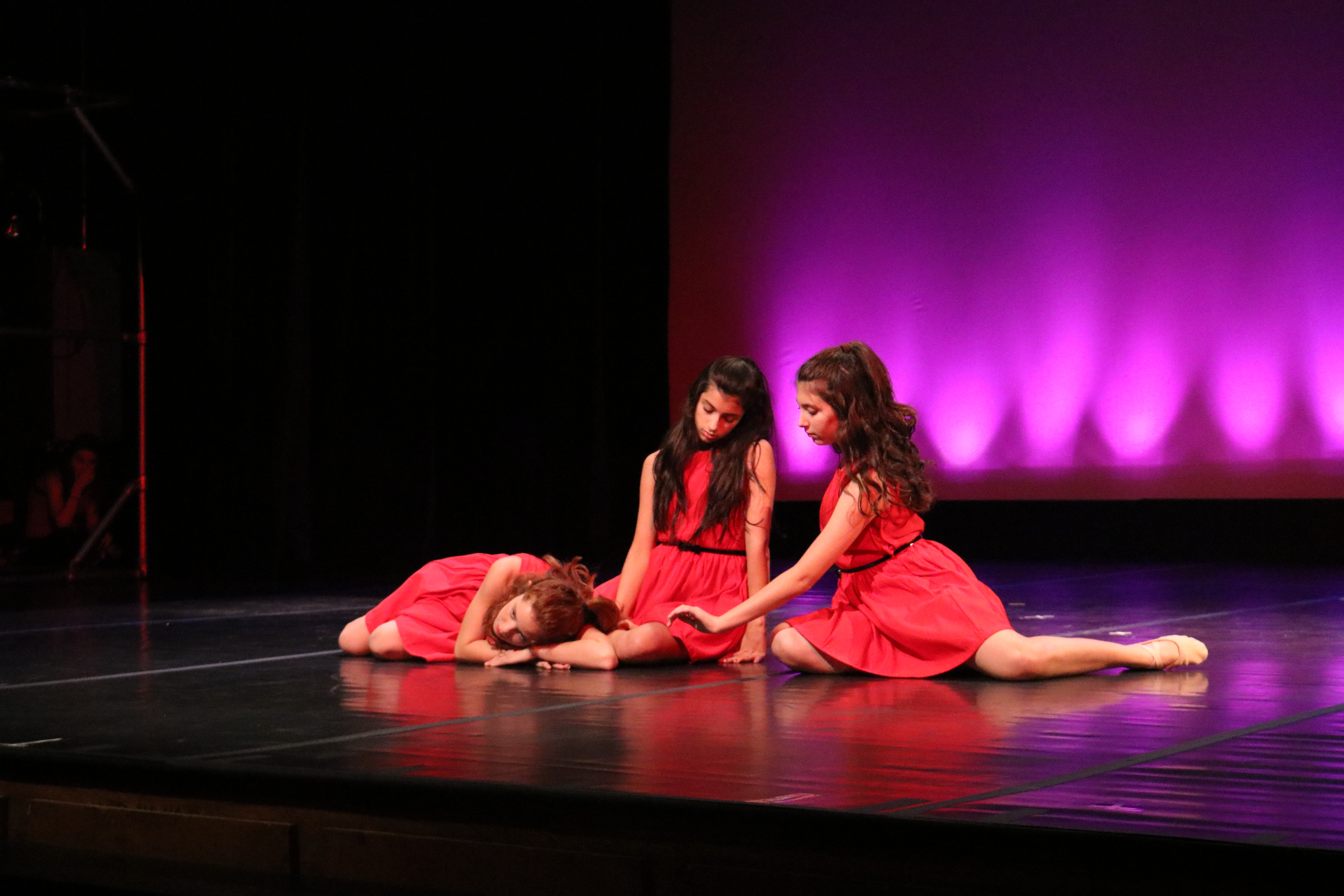 Izzy Kessner '22, Dani Cohen '22 and Dani Winkler '22 perform a contemporary dance.